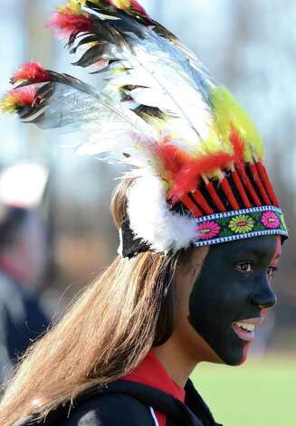 Fairfield Warde junior Jasmine Howell sports a feather headdress in celebration of the Thanksgiving day football game against cross town rival Fairfield Ludlowe at Fairfield Ludlowe High School on Thursday, Nov. 24, 2011. Photo: Amy Mortensen / Connecticut Post Freelance