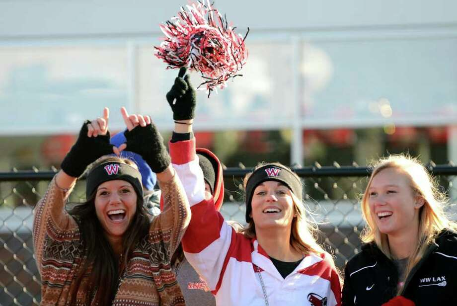 Fairfield Warde seniors Molly Robb, Jenny Jacob and Maureen Burke cheer as Fairfield Warde scores a touchdown during the Thanksgiving day football game against cross town rival Fairfield Ludlowe at Fairfield Ludlowe High School on Thursday, Nov. 24, 2011. Photo: Amy Mortensen / Connecticut Post Freelance