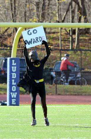 "A person dressed as Batman holding a ""Go Warde"" sign runs out onto the field during the Fairfield Ludlowe vs. Fairfield Warde Thanksgiving day football game at Fairfield Ludlowe High School on Thursday, Nov. 24, 2011. Photo: Amy Mortensen / Connecticut Post Freelance"