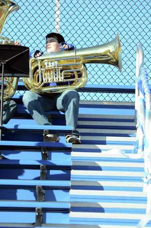 Fairfield Ludlowe tuba player Matt Grant sits in the stands with his fellow bandmates during the Fairfield Ludlowe vs. Fairfield Warde Thanksgiving day football game at Fairfield Ludlowe High School on Thursday, Nov. 24, 2011. Photo: Amy Mortensen / Connecticut Post Freelance