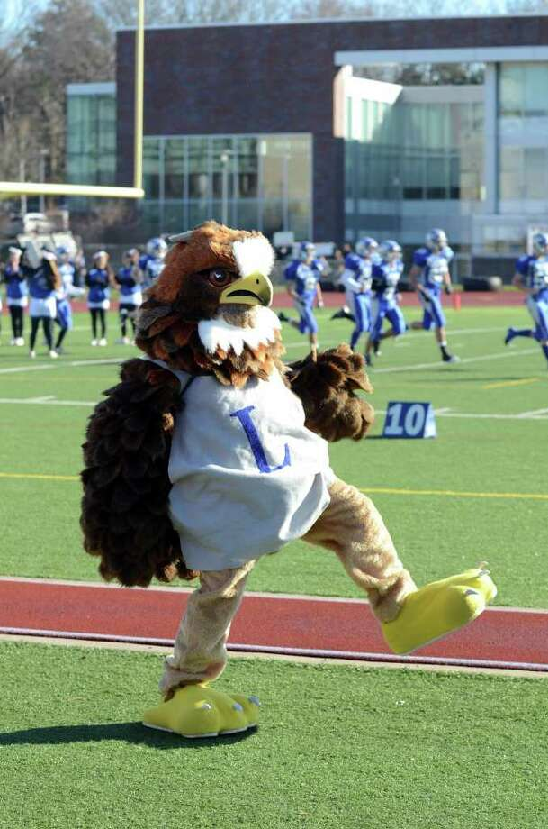 Fairfield Ludlowe's Falcon mascot dances on the sidelines during the Fairfield Ludlowe vs. Fairfield Warde Thanksgiving day football game at Fairfield Ludlowe High School on Thursday, Nov. 24, 2011. Photo: Amy Mortensen / Connecticut Post Freelance