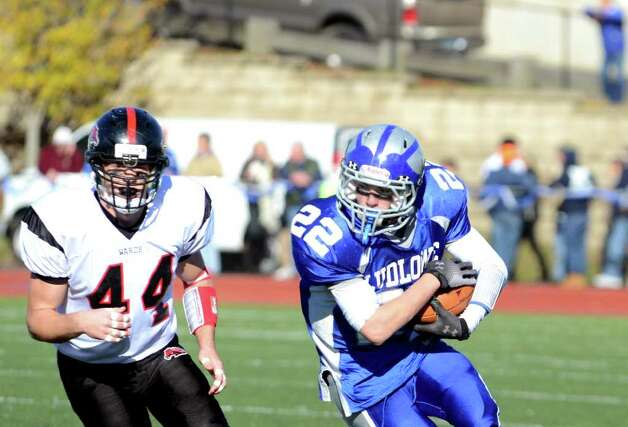 Fairfield Ludlowe ball carrier Stephen Scholz (22) protects the ball as he glances back at Fairfield Warde's Joe Marx during the Thanksgiving day football game at Fairfield Ludlowe High School on Thursday, Nov. 24, 2011. Photo: Amy Mortensen / Connecticut Post Freelance