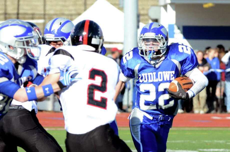 Fairfield Ludlowe's Stephen Scholz (22) carries the ball for yardage during the Thanksgiving day football game against Fairfield Warde at Fairfield Ludlowe High School on Thursday, Nov. 24, 2011. Photo: Amy Mortensen / Connecticut Post Freelance