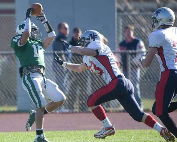 New Milford's Liam Lynch catches a touchdown pass against New Fairfield during their SWC football game Thursday, Nov. 24, 2011, at New Milford High. The Rebels' James Colella defends on the play. Photo: Barry Horn