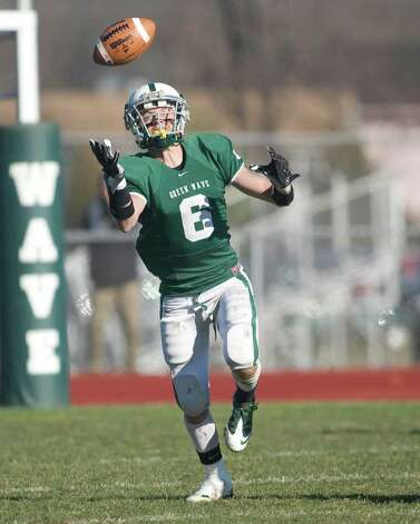 New Milford's Kam Bradshaw bobbles a pass but makes the reception during the Green Wave's SWC football game against New Fairfield Thursday, Nov. 24, 2011, at New Milford High School. Photo: Barry Horn