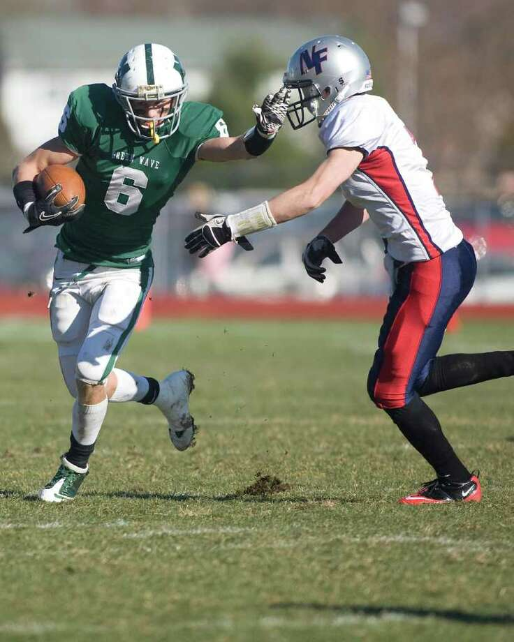 New Fairfield cornerback Louis Falcone closes in on New Milford's Kam Bradshaw during their SWC football game Thursday, Nov. 24, 2011, at New Milford High School. Photo: Barry Horn / The News-Times Freelance