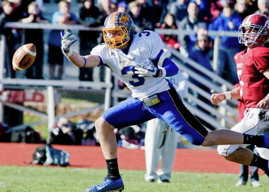 Brookfield High School's Ralph Schatz reaches for a pass in a football game against Bethel High School, played at Bethel. Thursday, Nov. 24, 2011 Photo: Scott Mullin / The News-Times Freelance