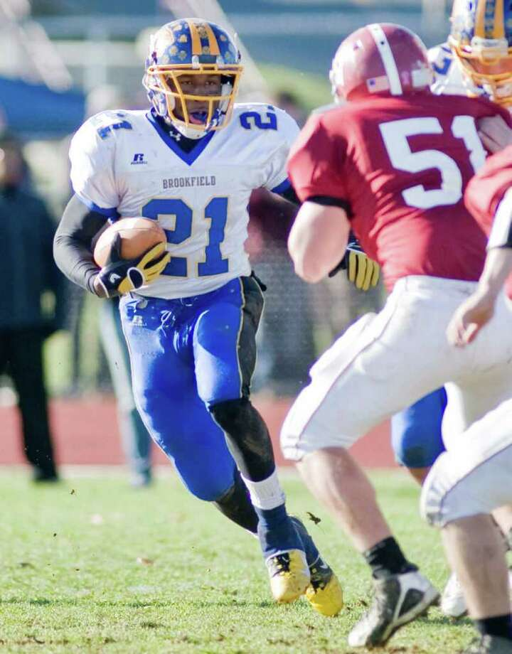 Brookfield High School's Leaon Gordon looks for a lane in a football game against Bethel High School, played at Bethel. Thursday, Nov. 24, 2011 Photo: Scott Mullin / The News-Times Freelance