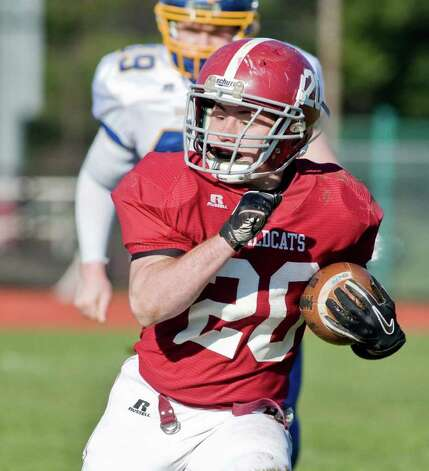 Bethel High School's William Quinn carries the football during a game against Brookfield High School, at Bethel. Thursday, Nov. 24, 2011 Photo: Scott Mullin / The News-Times Freelance