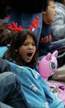 Cortney Owenby, 10, yawns as she waits for start of the 62nd Annual Holiday Parade on Thanksgiving Day in downtown Houston Thursday, Nov. 24, 2011. Photo: Melissa Phillip, Houston Chronicle / © 2011 Houston Chronicle