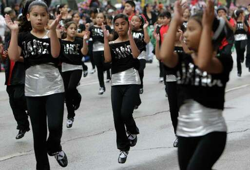 Scroggins Elementary Tappers perform during the 62nd Annual Holiday Parade on Thanksgiving Day. Photo: Melissa Phillip, Houston Chronicle / © 2011 Houston Chronicle