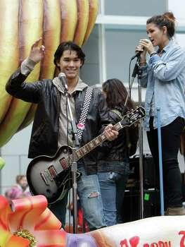 TwilightÕs Booboo Stewart, performing with his sister, Fivel, during the 62nd Annual Holiday Parade on Thanksgiving Day in downtown Houston Thursday, Nov. 24, 2011. Photo: Melissa Phillip, Houston Chronicle / © 2011 Houston Chronicle