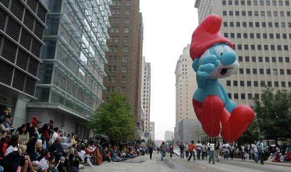 Smurf balloon floats down Fannin St. during  the 62nd Annual Holiday Parade on Thanksgiving Day in downtown Houston Thursday, Nov. 24, 2011. Photo: Melissa Phillip, Houston Chronicle / © 2011 Houston Chronicle