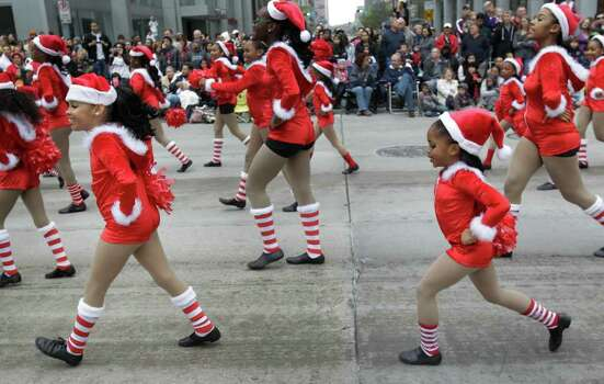 The group Kids in Dance perform during the 62nd Annual Holiday Parade on Thanksgiving Day in downtown Houston Thursday, Nov. 24, 2011. Photo: Melissa Phillip, Houston Chronicle / © 2011 Houston Chronicle