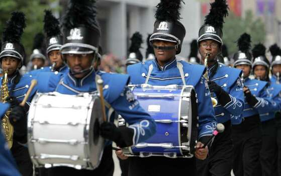 Members of the John Tyler Big Blue Band perform during the 62nd Annual Holiday Parade on Thanksgiving Day in downtown Houston Thursday, Nov. 24, 2011. Photo: Melissa Phillip, Houston Chronicle / © 2011 Houston Chronicle