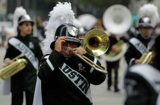 Stephen F. Austin High School marching band performs during the 62nd Annual Holiday Parade on Thanksgiving Day in downtown Houston Thursday, Nov. 24, 2011. Photo: Melissa Phillip, Houston Chronicle / © 2011 Houston Chronicle