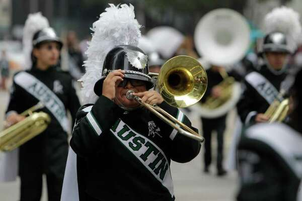 Stephen F. Austin High School marching band performs during the 62nd Annual Holiday Parade on Thanksgiving Day in downtown Houston Thursday, Nov. 24, 2011.