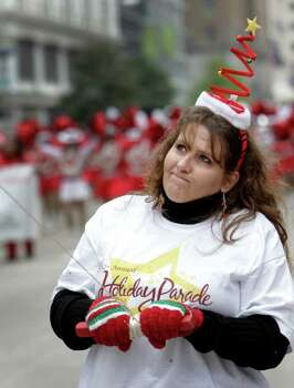 Heather Smith works to keep hold of her rope on the Nutcracker balloon float during the 62nd Annual Holiday Parade on Thanksgiving Day in downtown Houston Thursday, Nov. 24, 2011. Photo: Melissa Phillip, Houston Chronicle / © 2011 Houston Chronicle