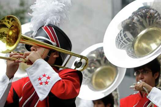 MacArthur High School band performing during the 62nd Annual Holiday Parade on Thanksgiving Day in downtown Houston Thursday, Nov. 24, 2011. Photo: Melissa Phillip, Houston Chronicle / © 2011 Houston Chronicle