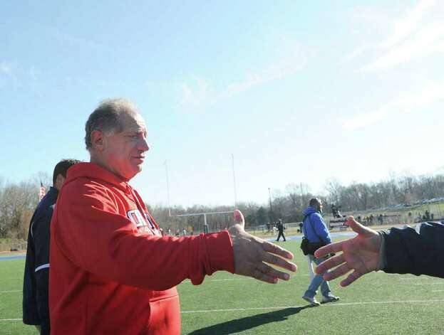 GHS football coach Rich Albonizio shakes hands at the conclusion of the FCIAC Football Championship game in which Staples High School defeated Greenwich High School 31-27 at Staples, Westport, Thursday afternoon, Nov. 24, 2011. Photo: Bob Luckey / Greenwich Time