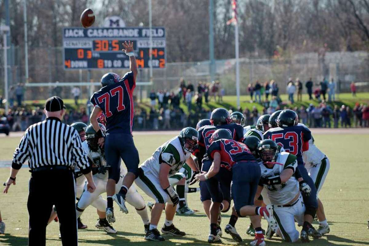 Norwalk kicks a field goal during high school football action, at Brien McMahon, Thursday Nov. 24, 2011.
