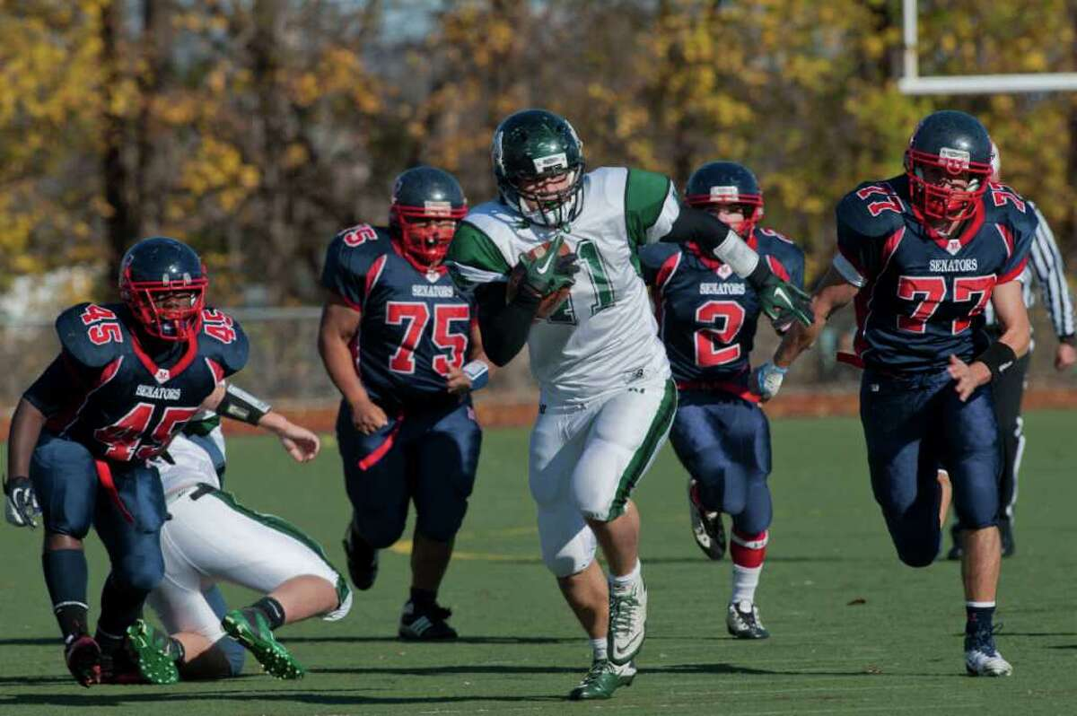 Norwalks's Gil Araujo rushes during high school football action, at Brien McMahon, Thursday Nov. 24, 2011.