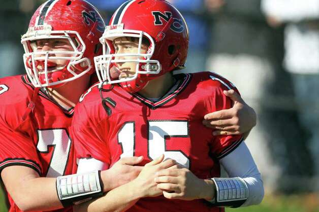 New Canaan offensive lineman Kalin Killenger celebrates with teammate Matt Milano following Milano's third quarter touchdown run in the Turkey Bowl. Led by Milano's arm and legs, New Canaan manhandled Darien, 42-21. Photo: J. Gregory Raymond / © J. Gregory Raymond for The Advocate