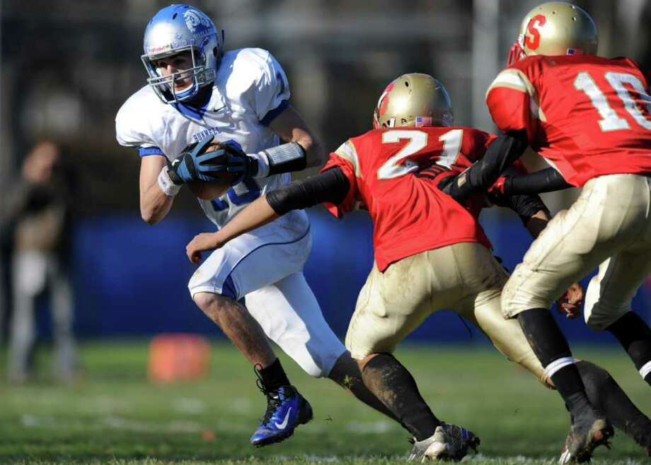 Bunnell's Matthew Stringfellow carries the ball as Stratford's David Gierula and Noah Provo, far right, defend during the annual Thanksgiving Day football game Thursday, Nov. 24, 2011 at Penders Field in Stratford, Conn. Photo: Autumn Driscoll / Connecticut Post