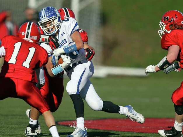 Darien RB Peter Gesualdi fights for additional yardage as New Canaan Ram defender Patrick Burke closes in. New Canaan clobbered Darien, 42-21 in the annual Turkey Bowl.  © J. Gregory Raymond Photo: J. Gregory Raymond / © J. Gregory Raymond for The Advocate