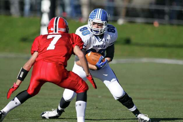 Darien WR Clay Barker attempts to elude Ram DB Grady Lynch during second half action between the two schools. Lynch and his New Canaan teammates beat up Darien, 42-21.  © J. Gregory Raymond Photo: J. Gregory Raymond / © J. Gregory Raymond for The Advocate