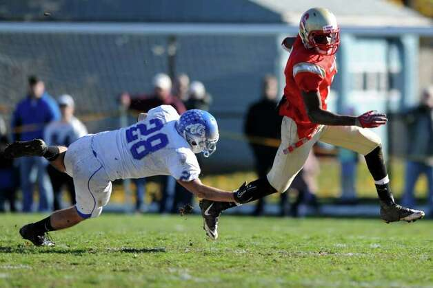 Stratford's Donald Graham avoids a tackle from Bunnell's Jason Kramer during the annual Thanksgiving Day football game Thursday, Nov. 24, 2011 at Penders Field in Stratford, Conn. Photo: Autumn Driscoll / Connecticut Post