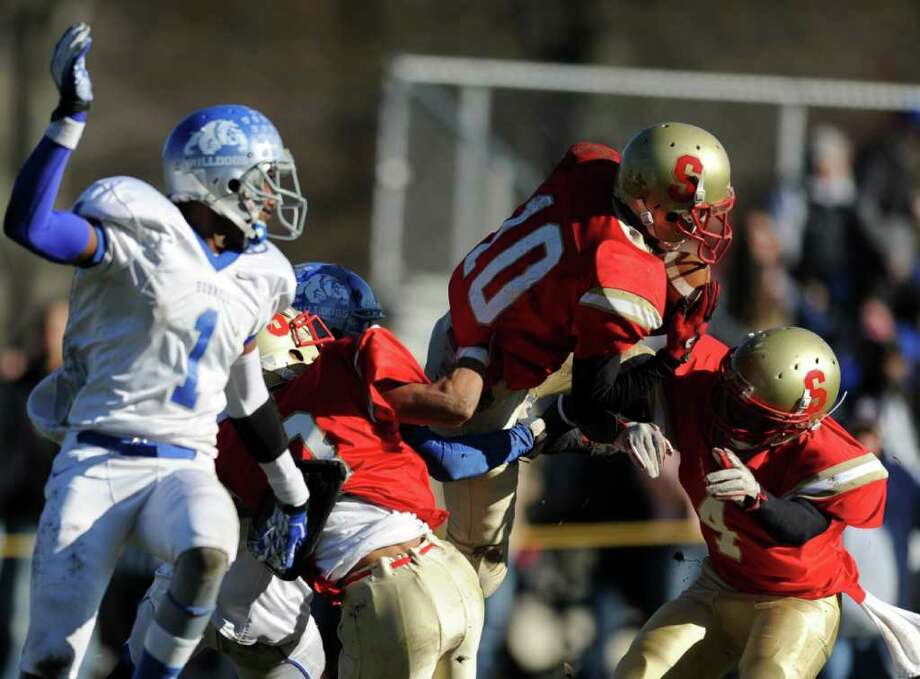 Stratford's Noah Provo intercepts a pass intended for Bunnell's Jawad Chisholm during the annual Thanksgiving Day football game Thursday, Nov. 24, 2011 at Penders Field in Stratford, Conn. Photo: Autumn Driscoll / Connecticut Post