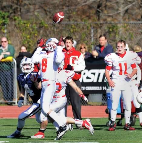 Nick Pulitano # 8 of Greenwich High School steps in front of Staples receiver James Frusciante # 4 to make an interception during the FCIAC Football Championship game in which Staples High School defeated Greenwich High School 31-27 at Staples, Westport, Thursday afternoon, Nov. 24, 2011. Watching from the sideline is Alex McMurray #11 of Greenwich. Photo: Bob Luckey / Greenwich Time