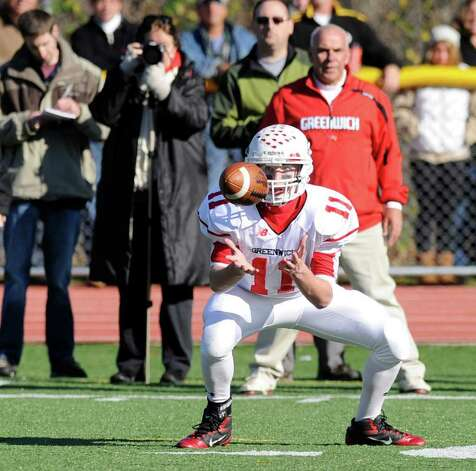 Alex McMurray # 11 of Greenwich High School makes a reception which he ran 68 yards for a touchdown in the 3rd quarter during the FCIAC Football Championship game in which Staples High School defeated Greenwich High School 31-27 at Staples, Westport, Thursday afternoon, Nov. 24, 2011. Photo: Bob Luckey / Greenwich Time