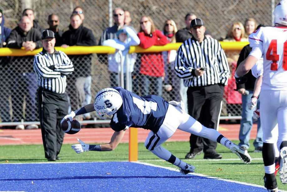 James Frusciante # 4 of Staples High School scores a touchdown during The FCIAC Football Championship game in which Staples High School defeated Greenwich High School 31-27 at Staples, Westport, Thursday afternoon, Nov. 24, 2011. Photo: Bob Luckey / Greenwich Time