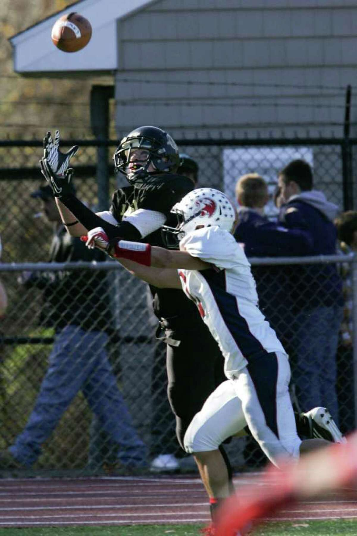Jonathan Law High School #5 Connor Falaguerra eyes the ball for a touchdown as Foran High School's # 2 Nicholas Weissauer defends during second half action on Thankgiving Day Match-up. Foran High School would win 48-13.