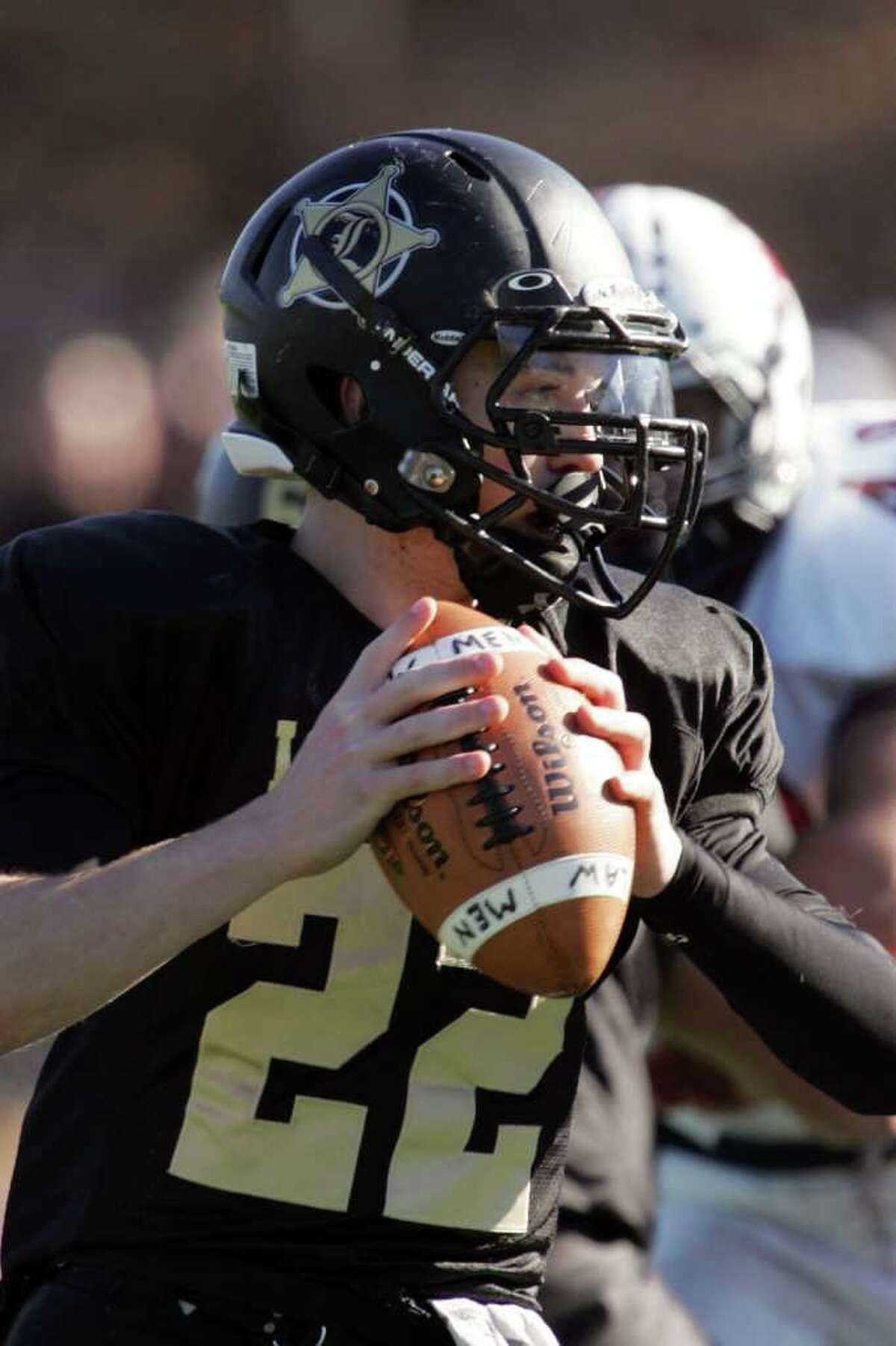 Jonathan Law High School's quarterback # 22 Timmy Maher looks down field during Thursday Thanksgiving Day Match-up against Foran High School. Foran High School would win 48-13.