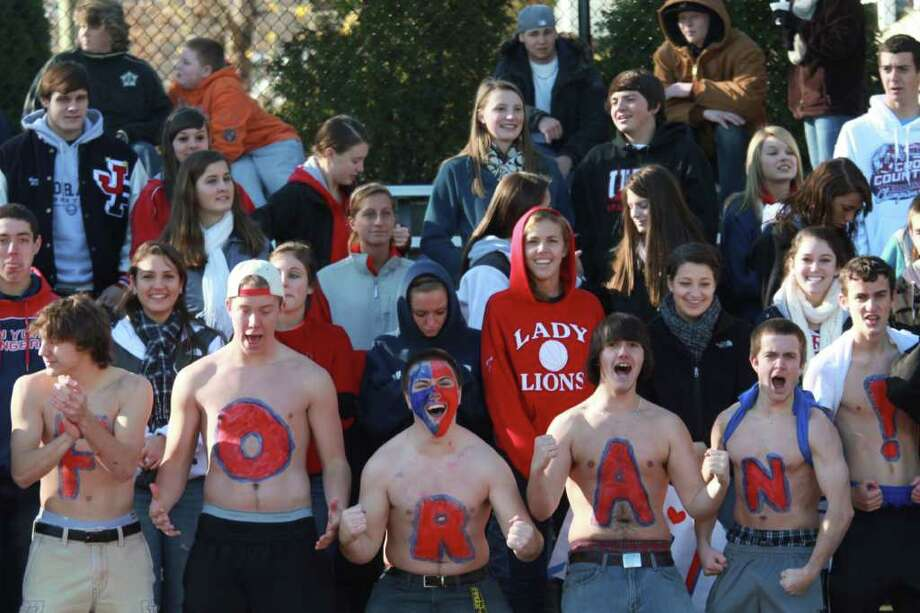 Loyal Foran High School's students brave the cold weather and cheer their team on during Thanksgiving Day Match-up against Jonathan Law High. Foran HS would win 48-13. Photo: Mike Ross