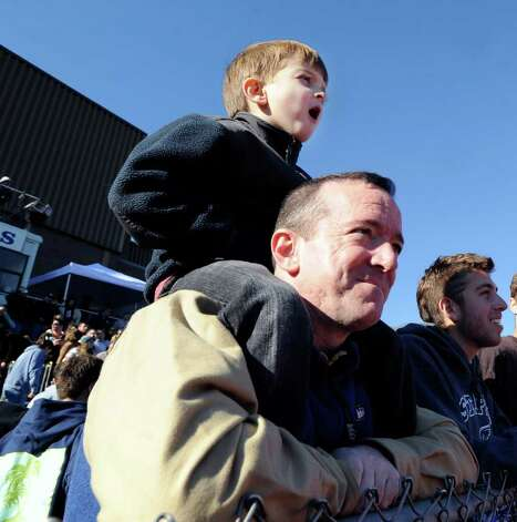 Wreckers fans John Meehan with his son Peter, 6, atop his shoulders, during the FCIAC Football Championship game in which Staples High School defeated Greenwich High School 31-27 at Staples, Westport, Thursday afternoon, Nov. 24, 2011. Photo: Bob Luckey / Greenwich Time