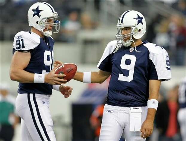 Dallas Cowboys long snapper L.P. LaDouceur (91) and quarterback Tony Romo (9) talk as  the practice field goal kicks before an NFL football game against the  Miami Dolphins Thursday, Nov. 24, 2011, in Arlington, Texas. Romo serves  as the holder for kicker  Dan Bailey. (AP Photo/Sharon Ellman)