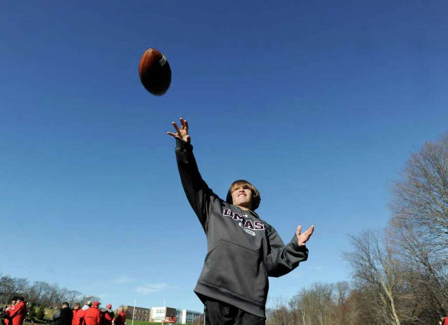 Alex Quirk, 11 of Greenwich, tosses the football around on the sideline  during halftime of the FCIAC Football Championship game in which Staples High School defeated Greenwich High School 31-27 at Staples, Westport, Thursday afternoon, Nov. 24, 2011. Photo: Bob Luckey / Greenwich Time