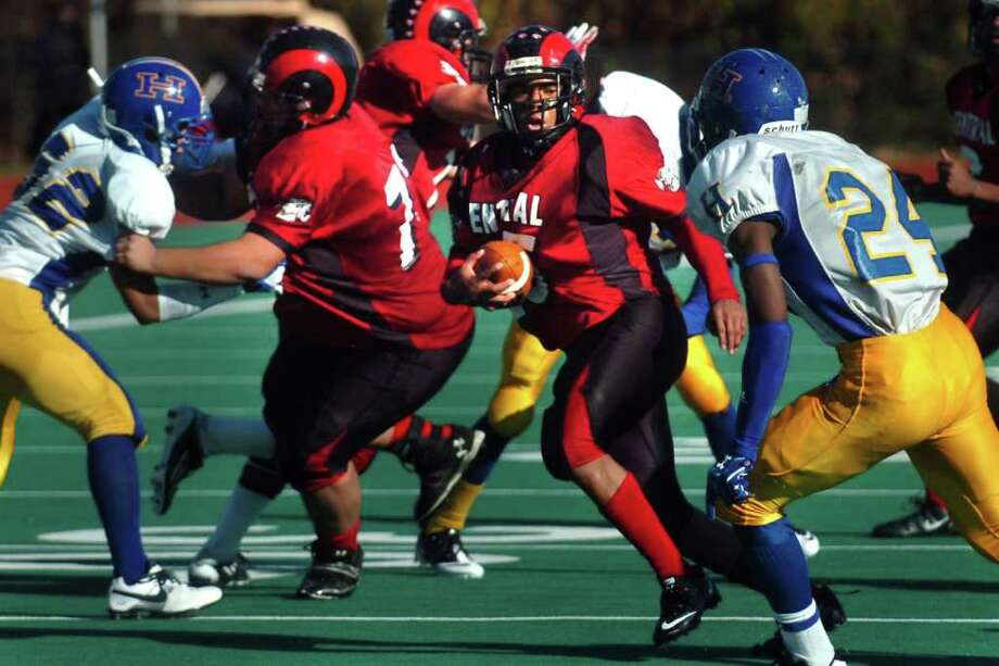 Central's Frederick Tuker rushes Harding vs. Central high school football action at Kennedy Stadium, Central High School, in Bridgeport, Conn. on Thanksgiving, Nov. 24th, 2011. Photo: Ned Gerard / Connecticut Post
