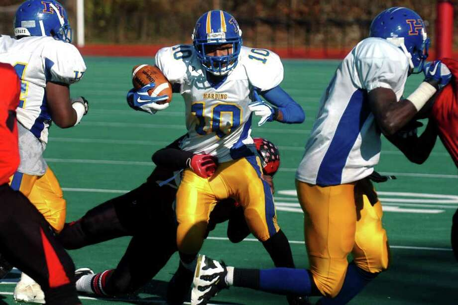 Harding's Jahaad Williams runs the ball during Harding vs. Central high school football action at Kennedy Stadium, Central High School, in Bridgeport, Conn. on Thanksgiving, Nov. 24th, 2011. Photo: Ned Gerard / Connecticut Post