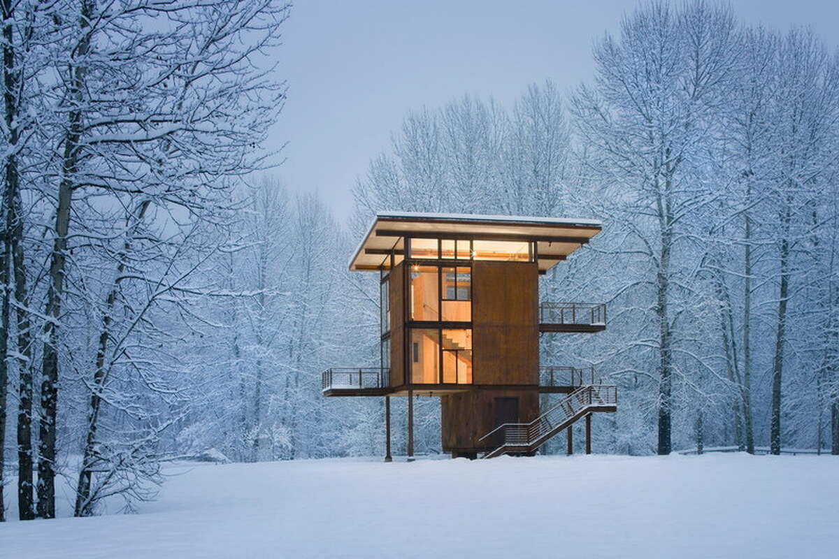 """Seattle's Olson Kundig Architects has made a name for itself designing cabins that are cozy when occupied and secure when vacant. Here are a bunch of their projects, starting with Delta Shelter, built in Mazama, Wash., in 2005. The cabin is a """"steel box on stilts,"""" near a floodplain, featuring 18-foot steel shutters that can be closed with a hand crank to protect it when the owners are away. Tom Kundig, of Olson Kundig Architects, was the lead architect."""