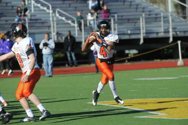Stamford's Bryan Boderick looks to pass as Westhill High School hosts Stamford High for a crosstown battle on the football field on Thanksgiving Day, November 24, 2011. Photo: Keelin Daly