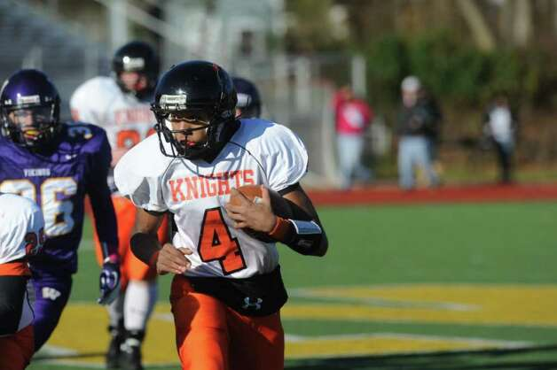 Stamford's Bryan Boderick carries as Westhill High School hosts Stamford High for a crosstown battle on the football field on Thanksgiving Day, November 24, 2011. Photo: Keelin Daly