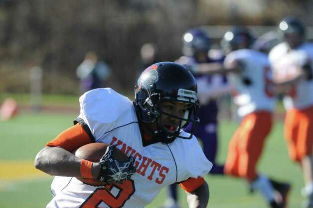 Stamford's Barry Boderick carries as Westhill High School hosts Stamford High for a crosstown battle on the football field on Thanksgiving Day, November 24, 2011. Photo: Keelin Daly