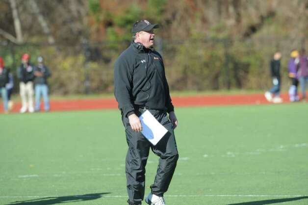 Stamford High football Coach Bryan Hocter guided the team to its best season record since 1995 sealing the 7-2 season with a win over Westhill as Westhill High School hosts Stamford High for a crosstown battle on the football field on Thanksgiving Day, November 24, 2011. Photo: Keelin Daly