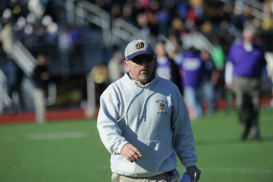 Westhill High football Coach Dick Cerone on the field as Westhill High School hosts Stamford High for a crosstown battle on the football field on Thanksgiving Day, November 24, 2011. Photo: Keelin Daly