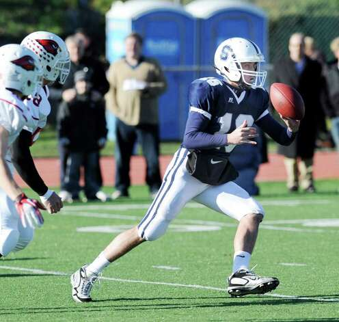 Staples High School QB Jack Massie # 16 options the ball during the FCIAC Football Championship game in which Staples High School defeated Greenwich High School 31-27 at Staples, Westport, Thursday afternoon, Nov. 24, 2011. Photo: Bob Luckey / Greenwich Time